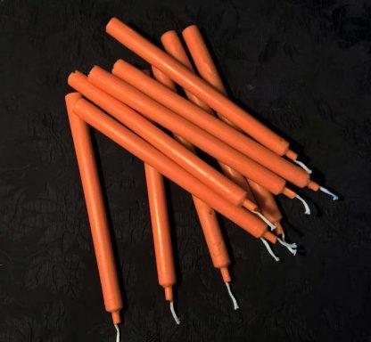 Восковые оранжевые свечи